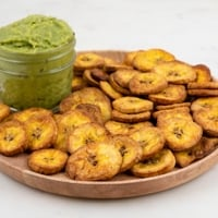 Square photo of a plate of plantain chips with some