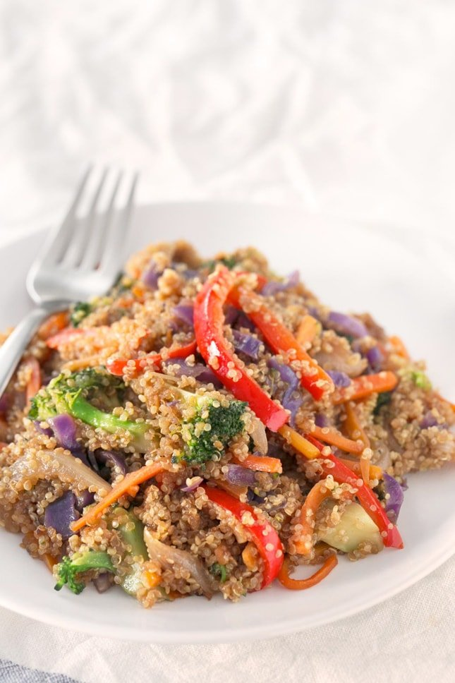 Photo of a bowl of quinoa stir fry with vegetables