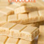 Close-up photo of some vegan white chocolate with the words vegan white chocolate