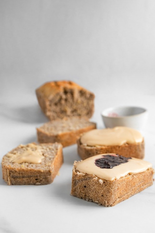 Photo of some slices of gluten-free bread with peanut butter and jelly on top