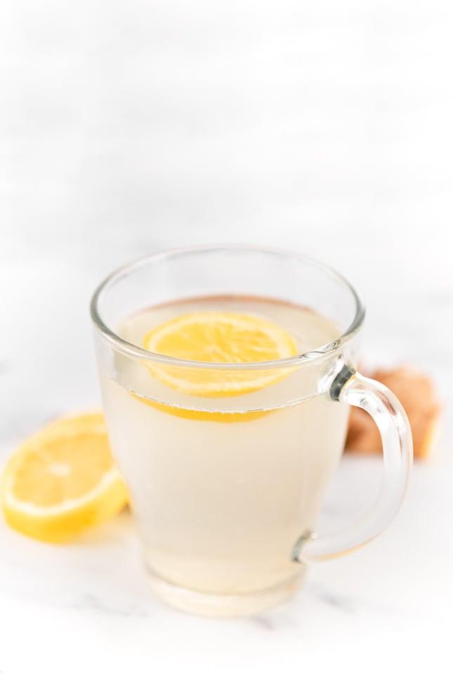Side photo of a cup of lemon ginger tea