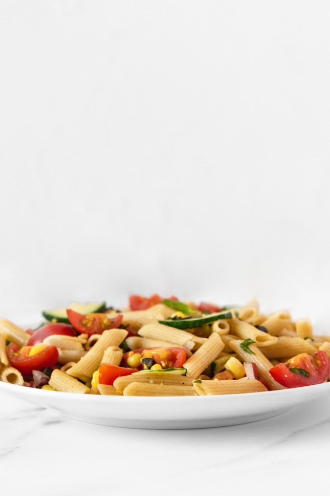 Side shot of a plate of vegan pasta salad