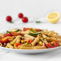 Square photo of a plate of vegan pasta salad