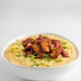 Photo of a bowl of vegan potato soup topped with tempeh bacon