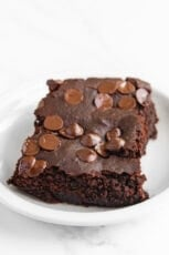 Photo of a piece of black bean brownies with vegan chocolate chips on top