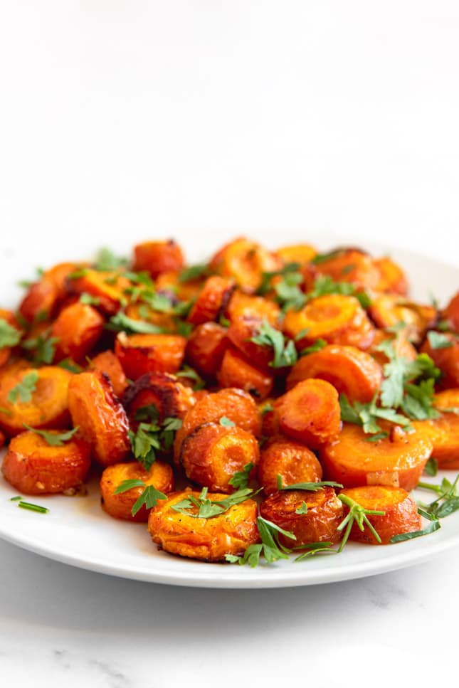 Side shot of a plate of roasted carrots