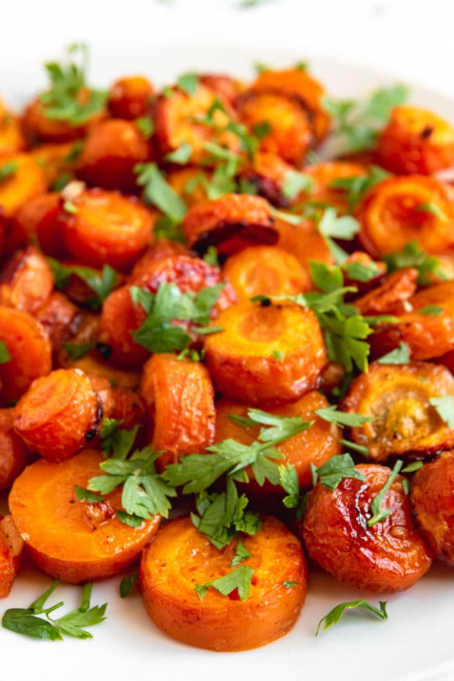 Close-up shot of a plate of roasted carrots