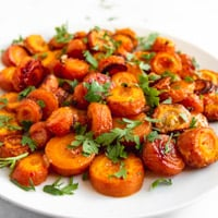 Square photo of a plate of roasted carrots