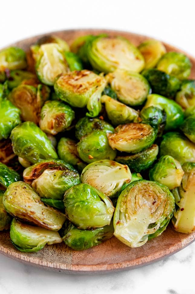Close-up shot of a plate of sauteed Brussels sprouts