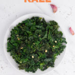 Photo of a plate of sauteed kale with the words sauteed kale