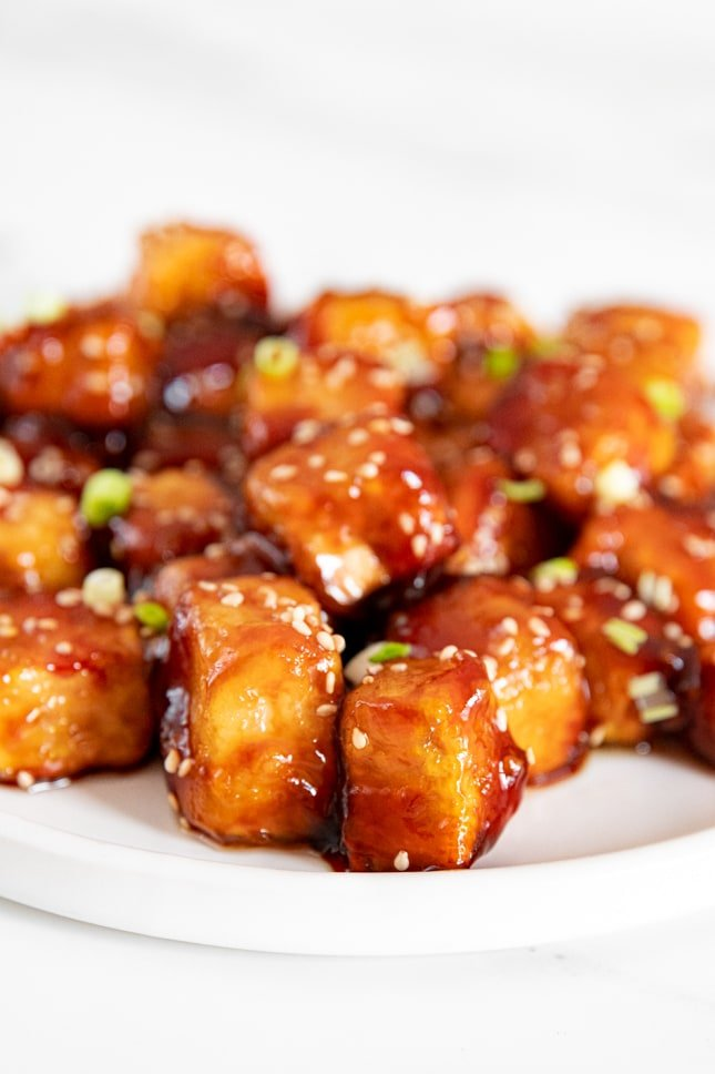 Side photo of a plate of sesame tofu