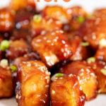 Close-up photo of a plate of sesame tofu with the words sesame tofu