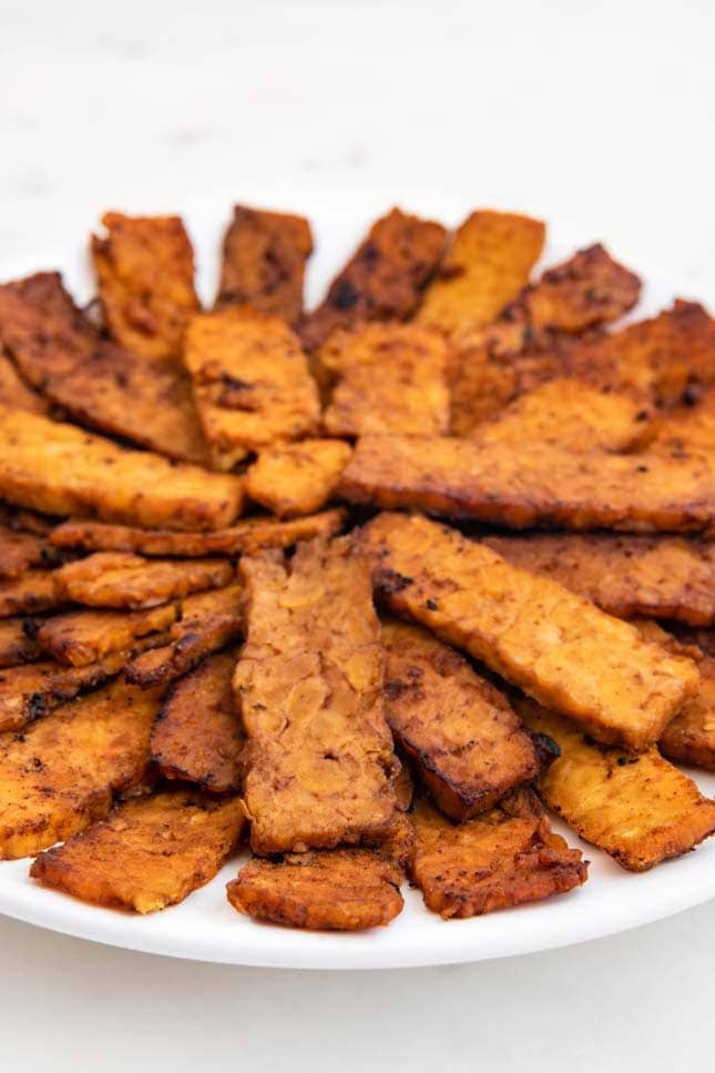Photo of a plate of tempeh bacon