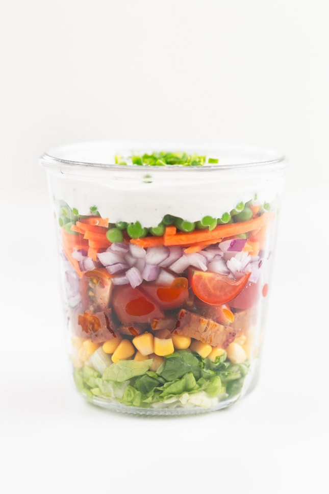 Photo of a bowl of a vegan 7-layer salad