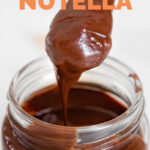 Close-up photo of a jar of vegan Nutella with the words vegan Nutella