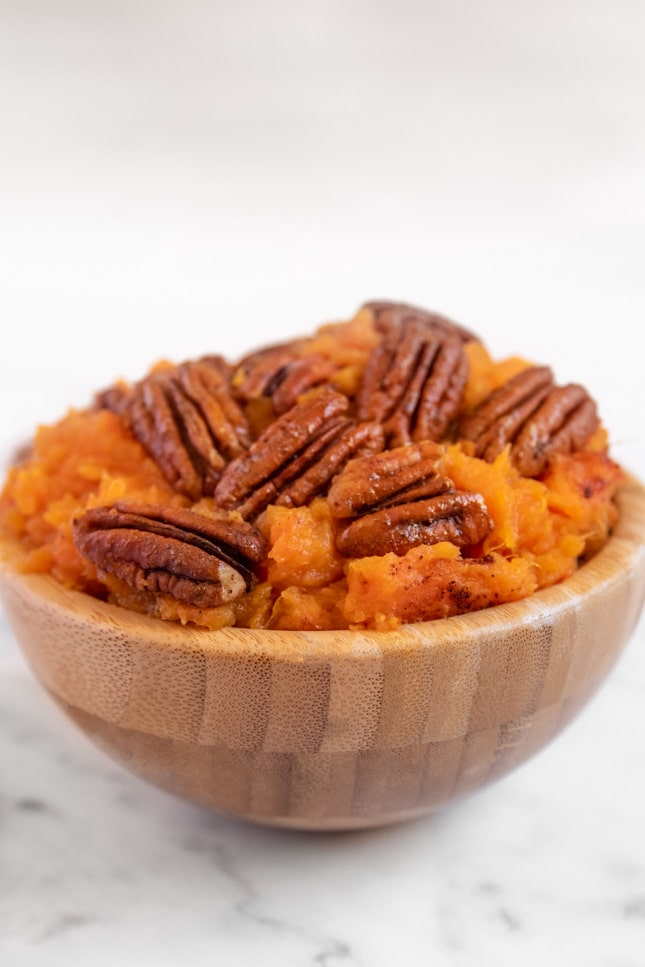 Side shot of a bowl of vegan sweet potato casserole