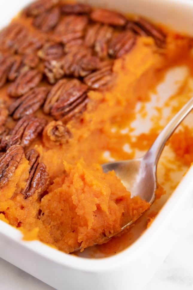 Photo of a spoonful of vegan sweet potato casserole