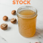 Photo of a glass jar of vegetable stock with the words how to make vegetable stock
