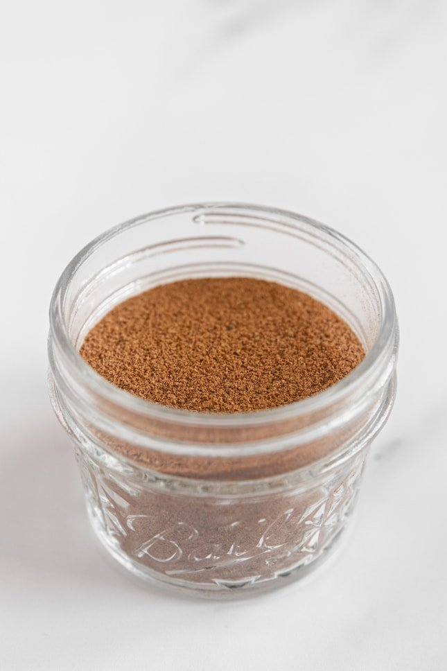 Photo of a glass jar of pumpkin pie spice