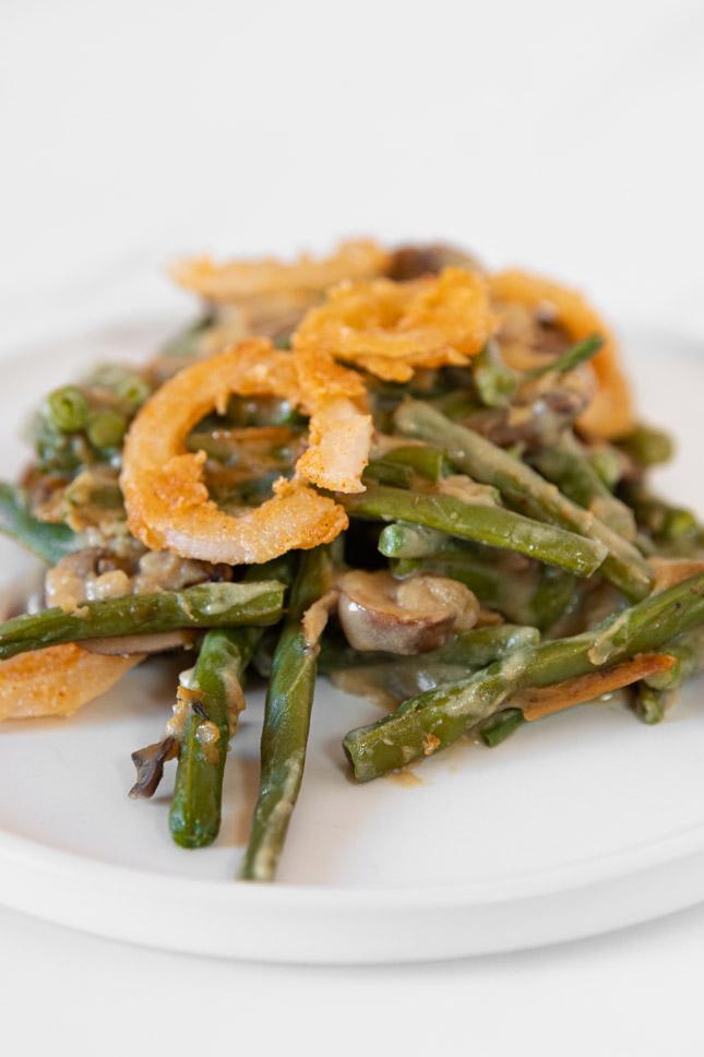 Close-up shot of a plate of vegan green bean casserole